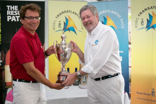 RORC Admiral Andrew McIrvine Presents Jean-Paul Riviere with the IMA Trophy Photo: RORC / Arthur Daniel