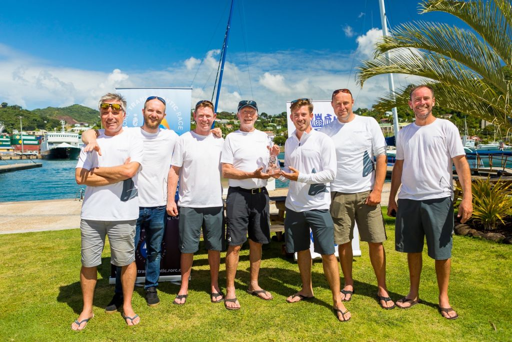 Peter Cunningham's MOD70 crew with Skipper Ned Collier Wakefield and the PowerPlay crew  (minus RORC CEO, Eddie Warden Owen) claim victory in the Multihull Class for the 5th edition of the race  © RORC/Arthur Daniel