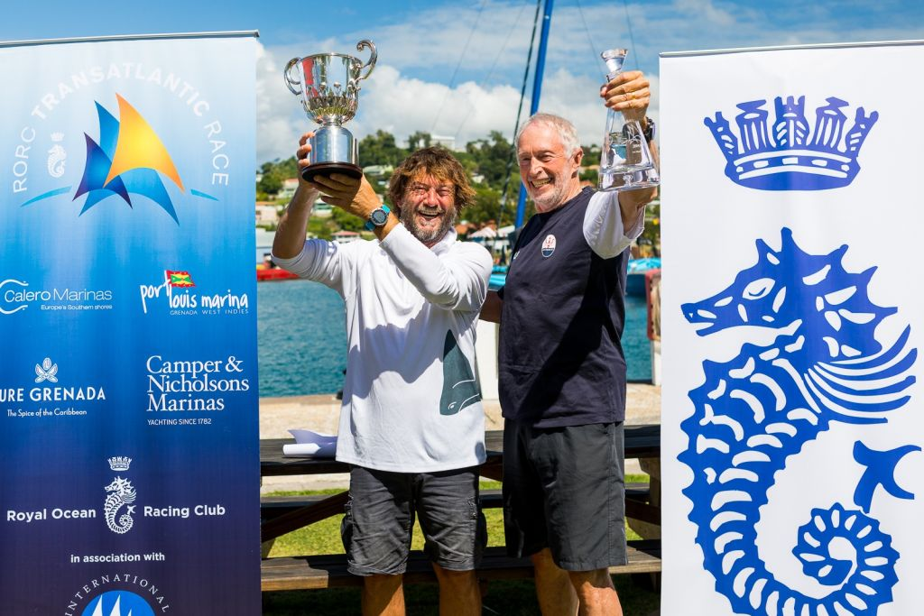 Giovanni Soldini (Multi 70 Maserati), holds the Multihull Line Honours Trophy and Peter Cunningham (MOD 70 PowerPlay) the MOCRA Class winners decanter at a prizegiving held at Port Louis Marina, Grenada  © RORC/Arthur Daniel