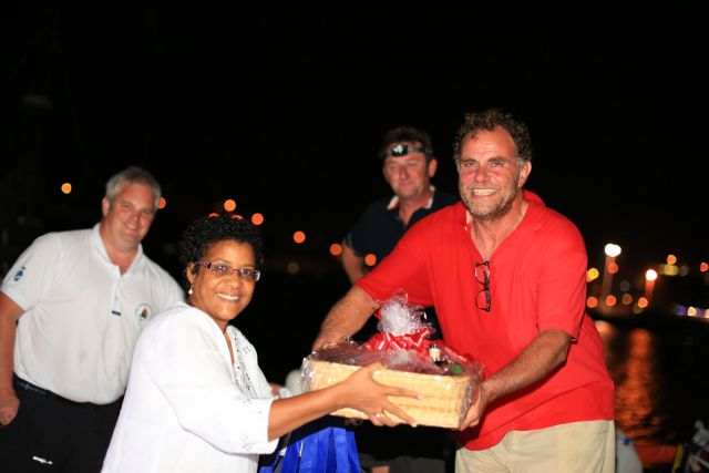 Nikoyan Roberts, Nautical Development Manager at the Grenada Tourism Authority, presented Maurice Benzaquen with a basket of Grenadian goods including Westerhall Rums. (RORC/Arthur Daniel)