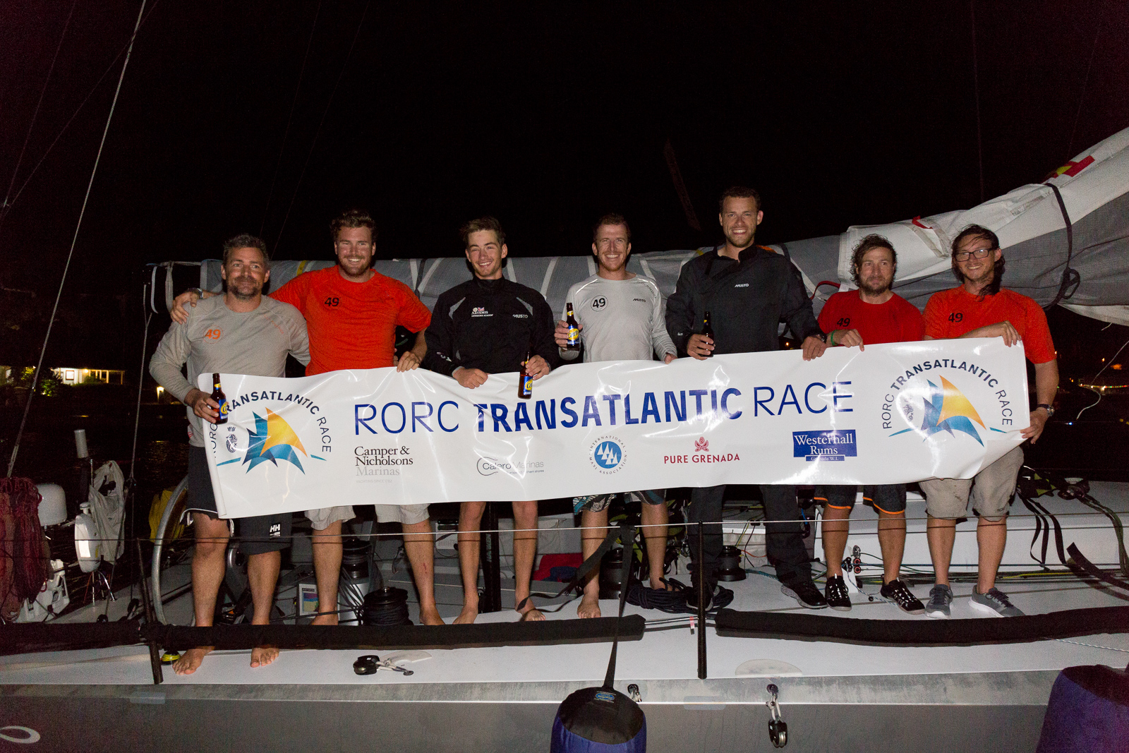Skipper, Olly Cotterell and Team Maverick, Inifiniti 46 having crossed the finish line in Grenada celebrate dockside at Port Louis Marina in the early hours of Saturday © RORC/Arthur Daniel
