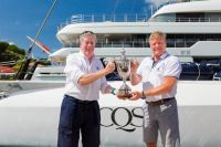 Ludde Ingvall's Australian Maxi CQS took line honours and was awarded the International Maxi Association (IMA) Transatlantic Trophy by Andrew McIrvine, IMA Secretary General © RORC/Arthur Daniel