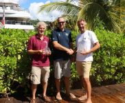 RORC Commodore, Steven Anderson presents Rupert Holmes (L) and Richard Palmer (R), owner of Jangada, JPK 10.10 with prizes for winning IRC Two and IRC Two Handed © RORC