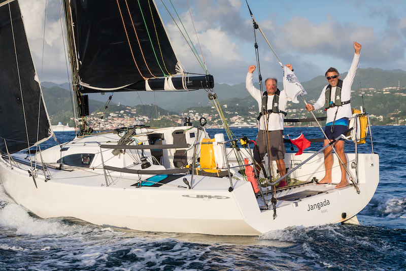 Richard Palmer and Jeremy Waitt celebrate crossing the finish of the 2019 RORC Transatlantic Race on board JPK 10.10 Janganda © RORC/Arthur Daniel