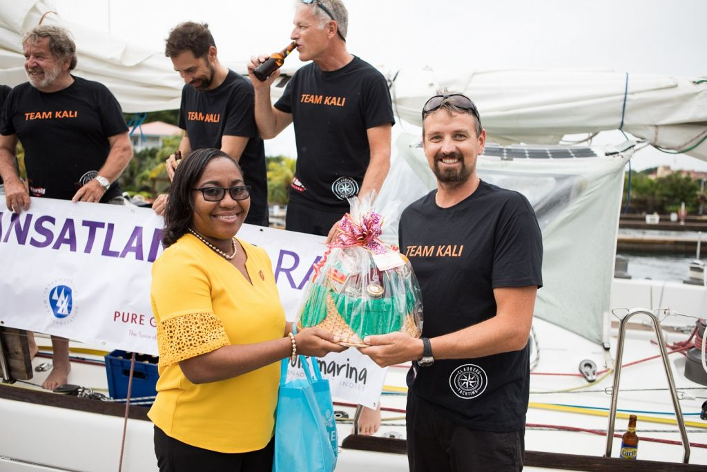Chinel Sandy from the Grenada Tourism Authority presented Kali with a basket of Grenadian goods - Photo © RORC / Arthur Daniel