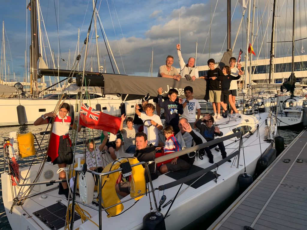 Children from the sailing school at Real Club Náutico de Arrecife climbed on board Richard Palmer's JPK 10.10 Jangada. They asked questions about what it's like to race two handed across the Atlantic Ocean © RORC