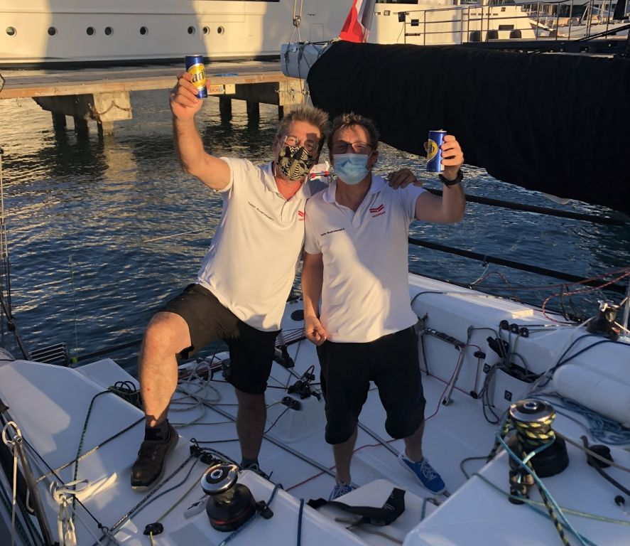 Enjoying a cold beer in Antigua after finishing the RORC Transatlantic Race: Sebastien Saulnier (R) and Christophe Affolter (L) racing Sun Fast 3300 Moshimoshi  © Helen Spooner/RORC