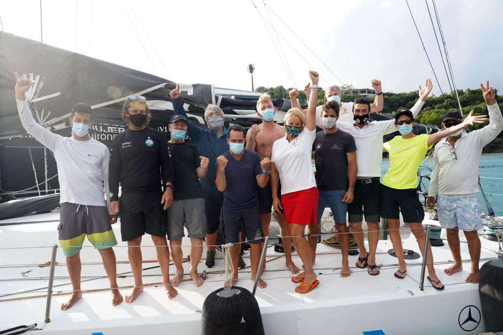 Celebrations on board Johannes Schwarz's Volvo 70 Green Dragon after winning the IMA Trophy and Monohull Line Honours in the  RORC Transatlantic Race - Finishing in an elapsed time of 9 days, 18 hours, 53 mins and 40 secs © Ed Gifford/RORC